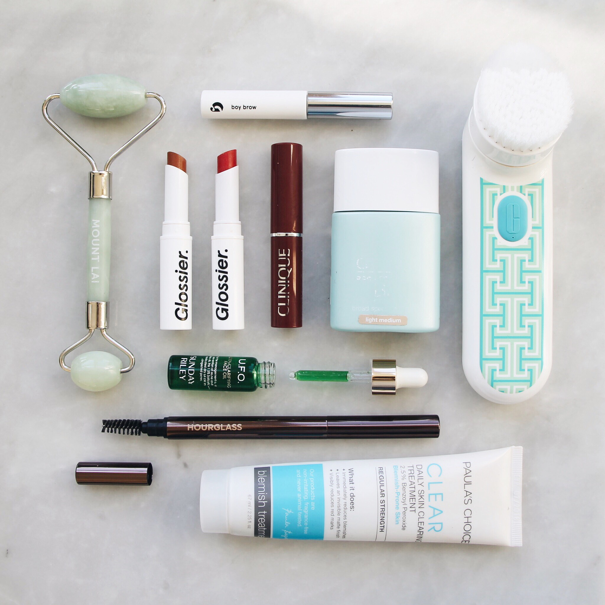 Top 10 Favorite Beauty Products of 2017, Glossier, Glossier Boy Brow, Glossier Generation G in Leo and Crush, Clinique Almost Lipstick Black Honey, Mount Lai, Jade Roller, The Jade Roller by Mount Lai, Sunday Riley UFO Oil, Clinique Acne Solutions BB Cream, Hourglass Eyebrow Pencil, Paula's Choice Acne Treatment, Clinique Sonic Cleansing Brush, Clinique x Jonathan Adler